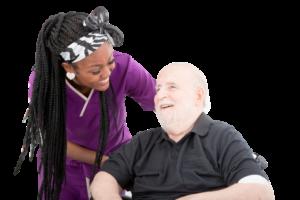A Horizon Home Care nurse assists an elderly man in a wheelchair.
